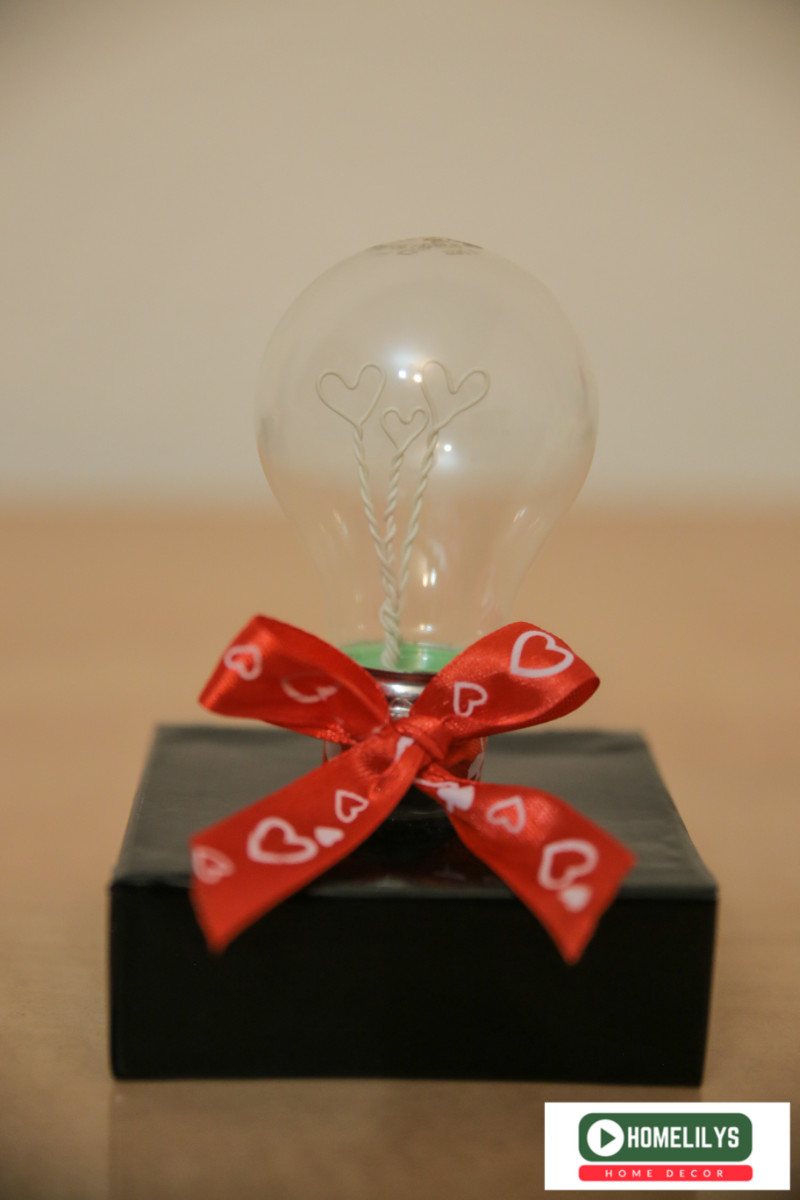 DIY gift idea from recycle electrical light bulb decorated with red ribbon