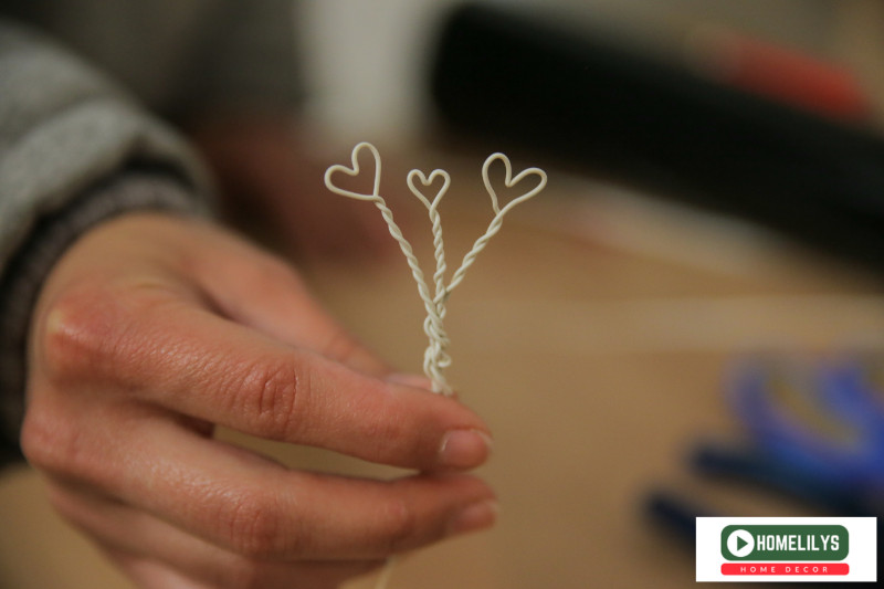 Use Plier to bend the electrical wire into 3 heart shaped string like this