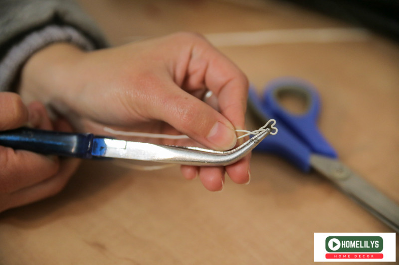 using pliers to shape the wire into heartshape