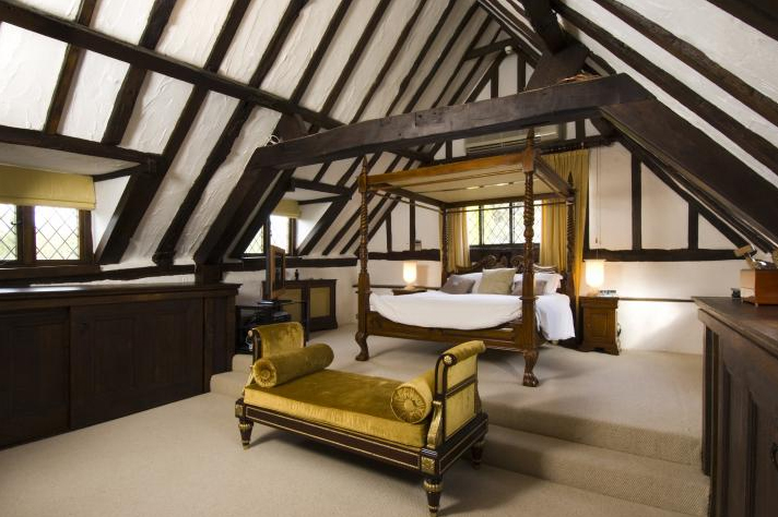 bedroom in a Tudor style cottage home