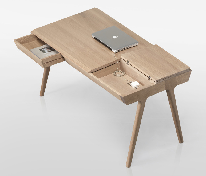 metis office desk with apple laptop and a magazin in a drawer