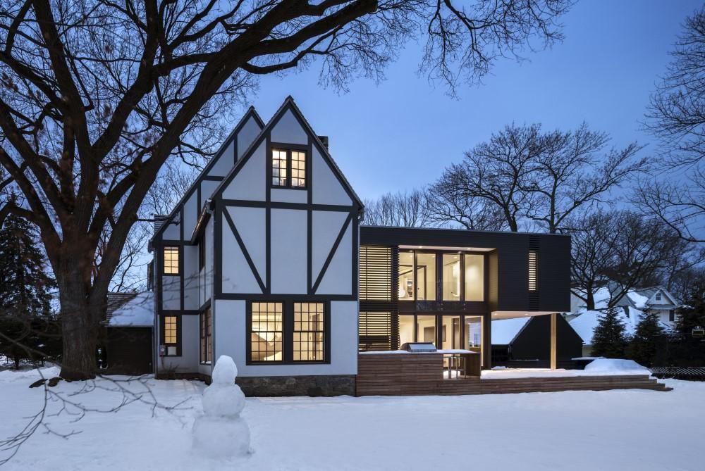 modernize tudor style residence in New York by Joeb Moore in Winter