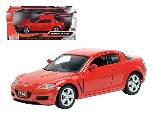 red mazda rx8 model car on cast iron