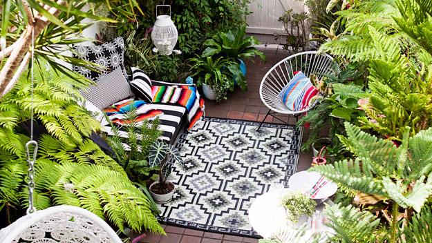 zen garden with acapulco chairs in a quiet garden