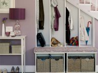 neat storage cabinet under staircase