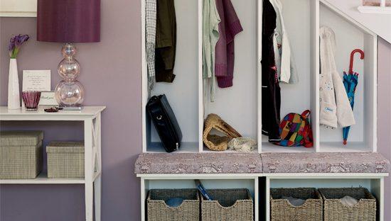 neat storage cabinet under staircase