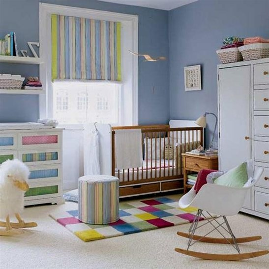rocking chair for young mother of a baby boy room design idea