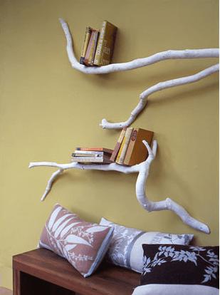 tree branch bookshelf on a yellow wall
