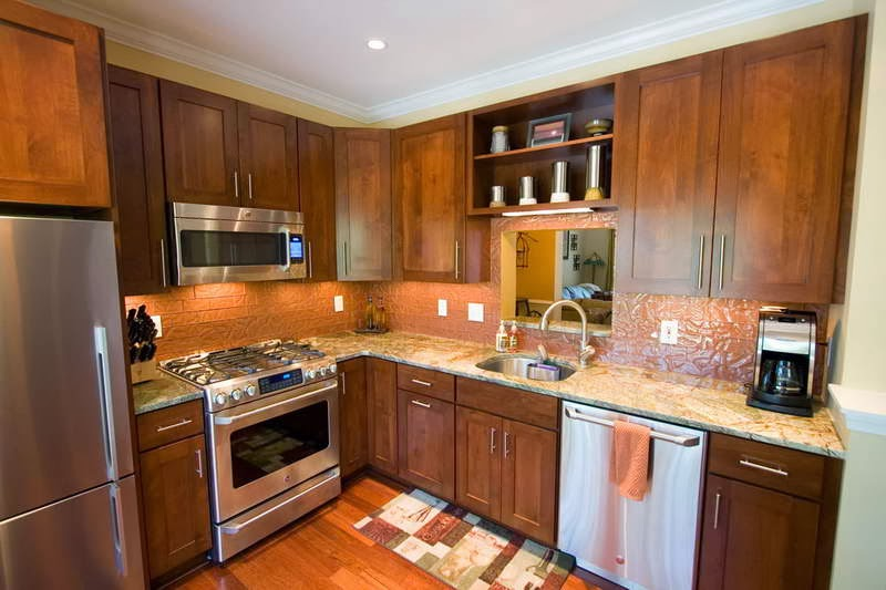L shape wooden kitchen in a traditional home