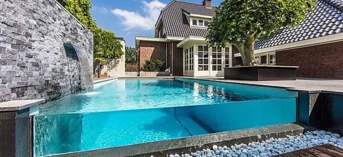 above ground glass rectangular pool for a luxury home