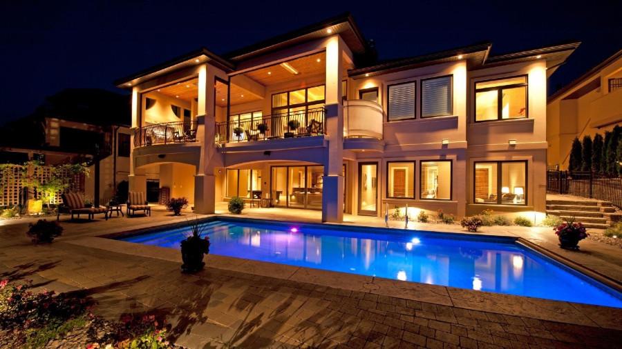 luxury mansion swimming pool at night