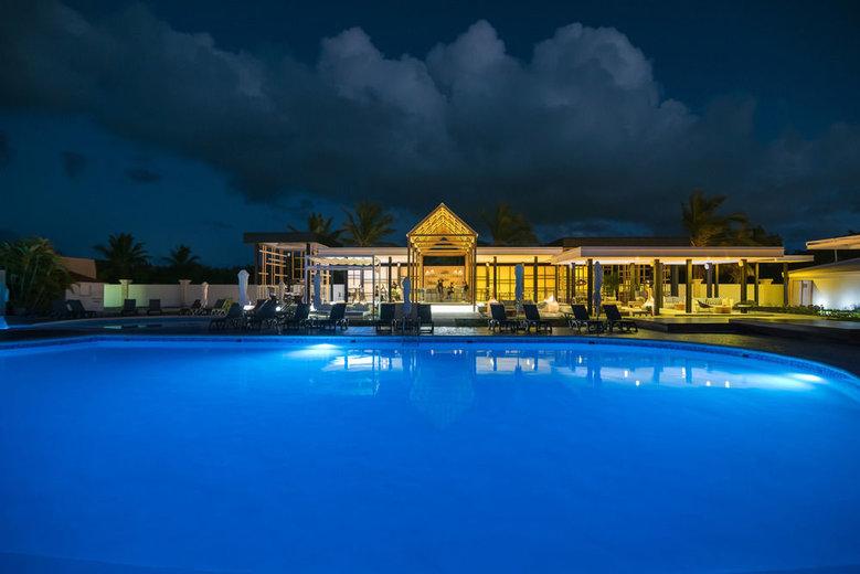 mansion resort world swimming pool at night