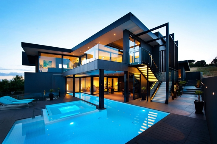 modern glass house with swimming pool view at night