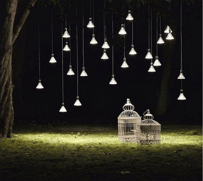 suspension lighting from tree at night outdoor decor