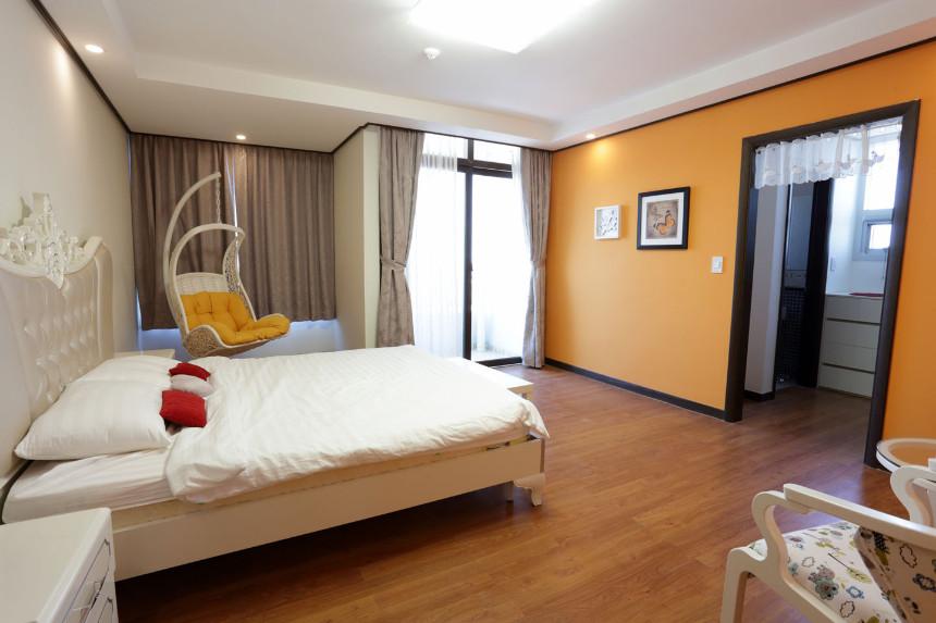 warm orange paint on de castle apartment in cambodia