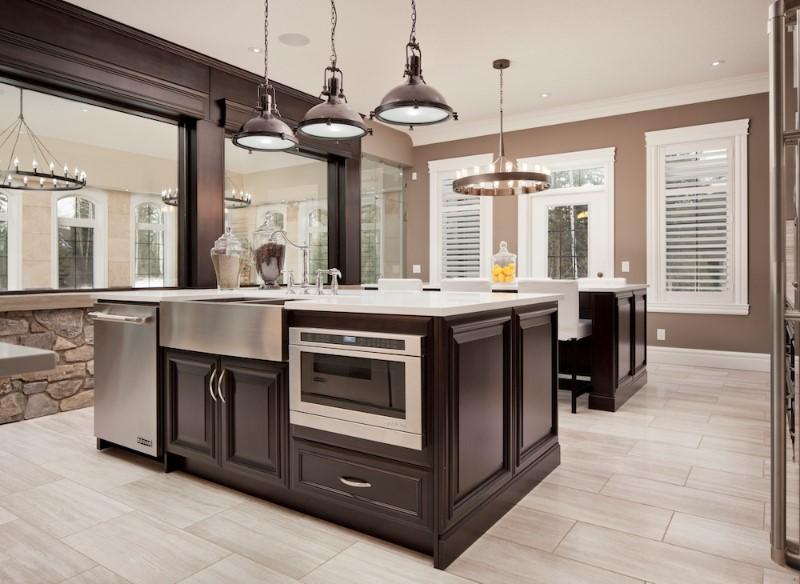 white cabinets dark island kitchen