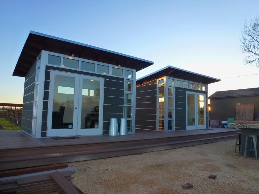 2 modern prefab home side by side in an evening sun