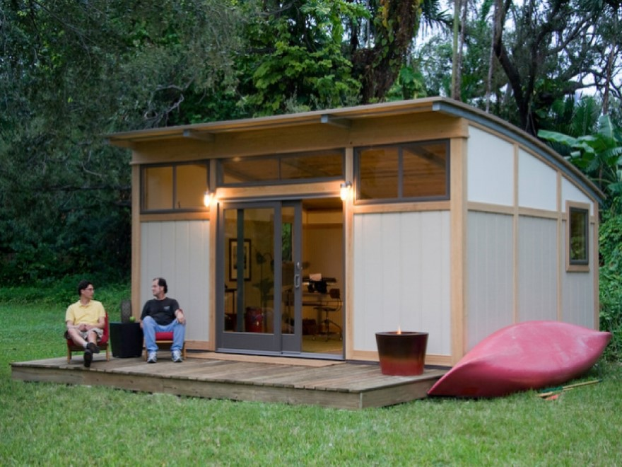 prefab office container with two men sitting in front of it