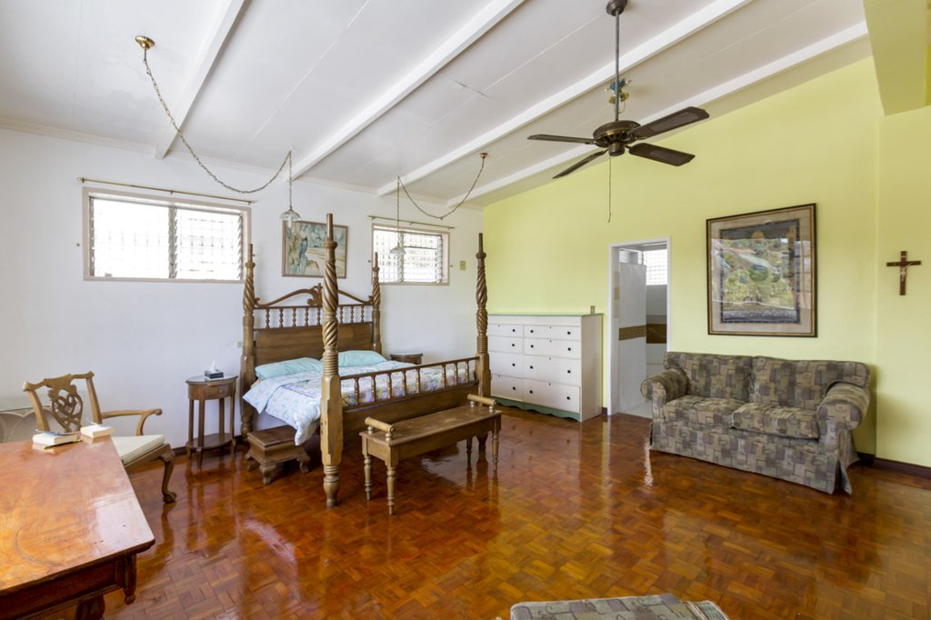 colonial style bedroom of the most expensive villa in the Philippines