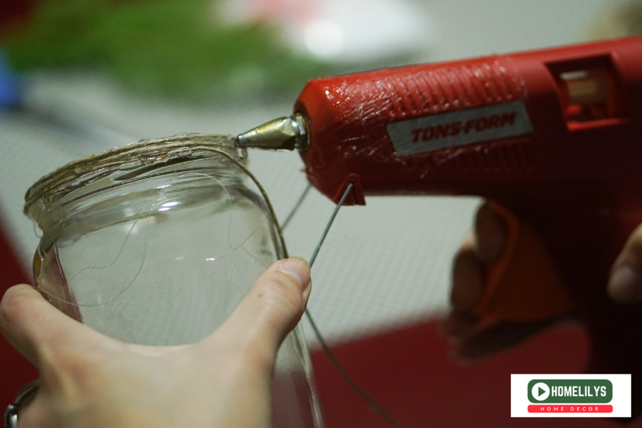 use glue gun to attach the laces to the old jam jar