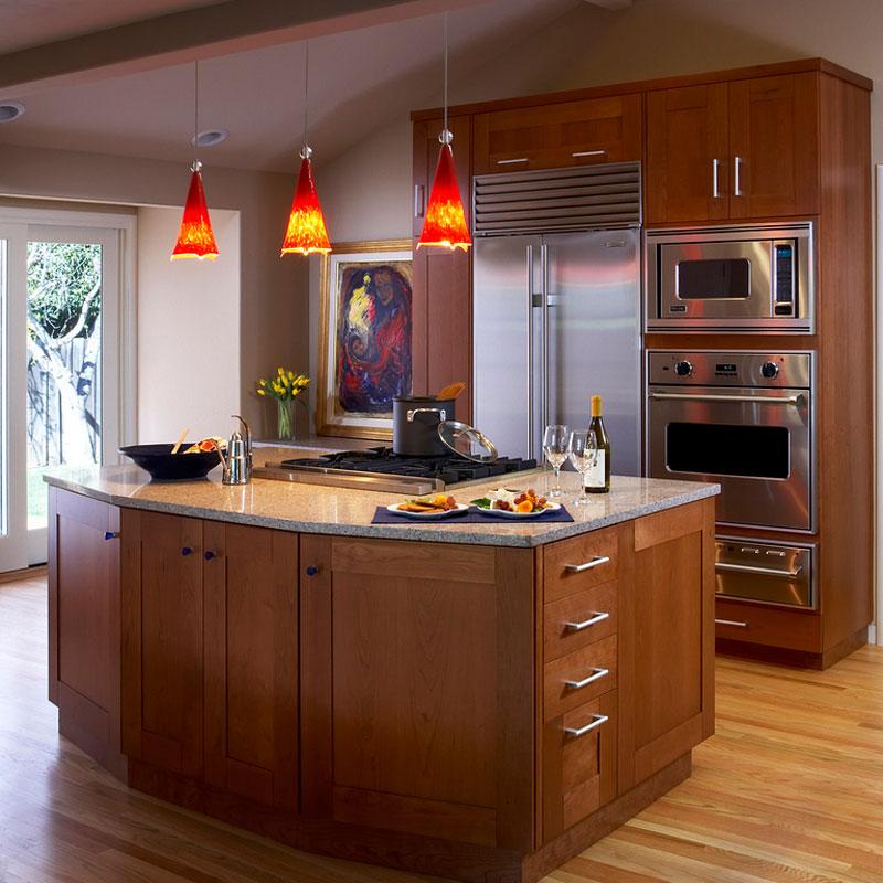 classic orange pendant light over kitchen area