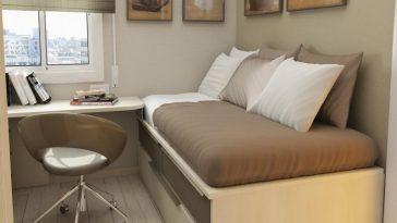 wooden single bed along side wall arrangement