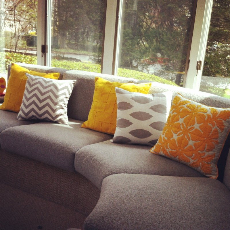 lots of pillows as a decorating ideas for frugal people