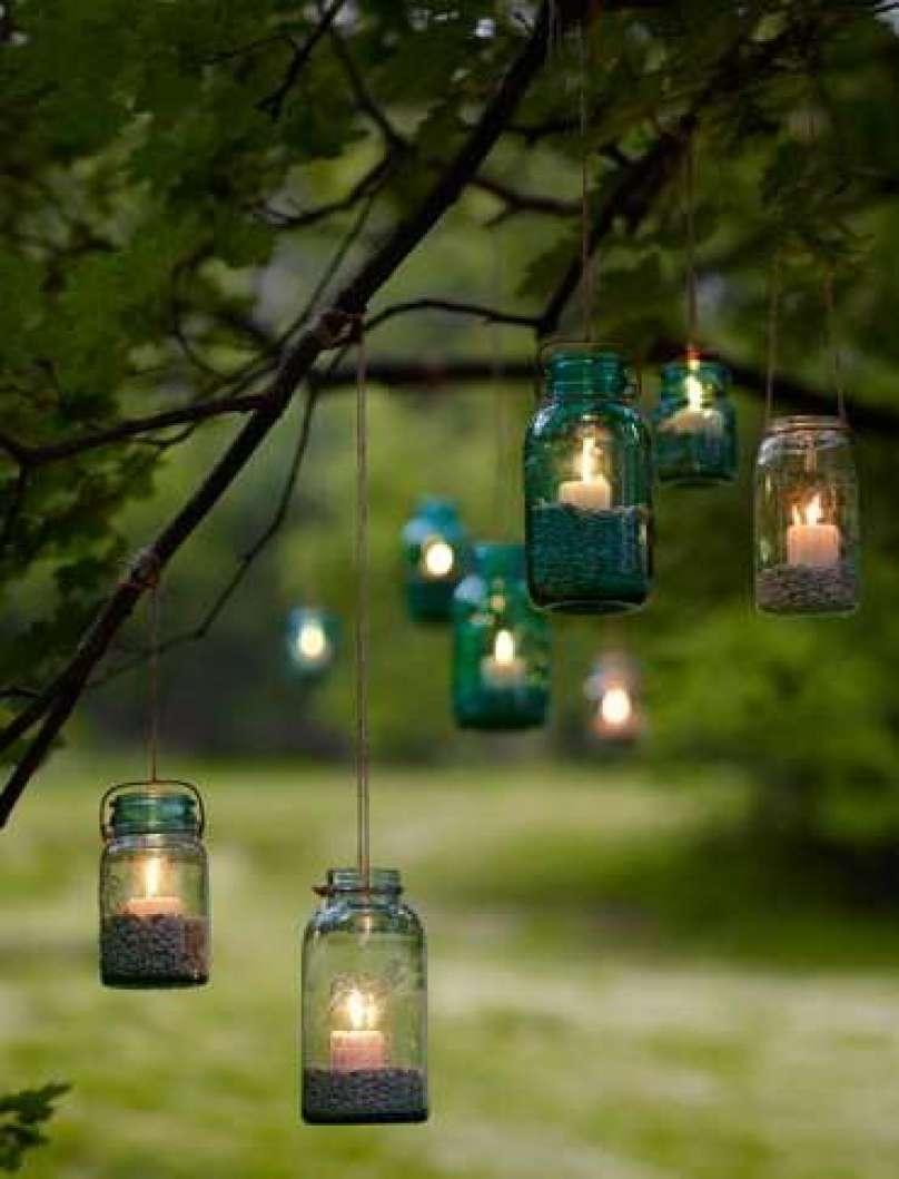 mason jar candle lighting on the tree