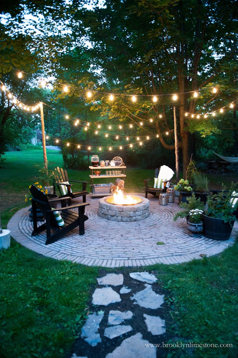 outdoor fire pit with string light for party