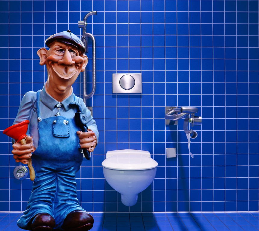 plumber in front of a toilet
