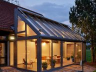 winter garden house extension at night