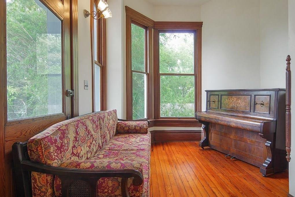 1892 victorian style home in texas with upright piano