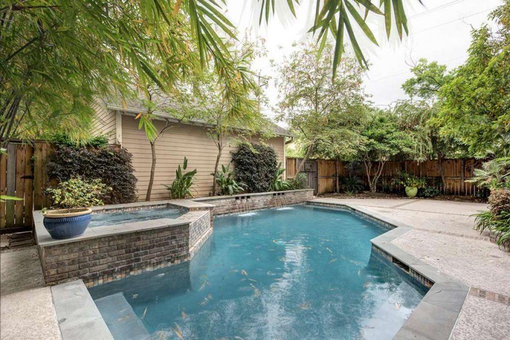 backyard swimming pool of Craftsman style home